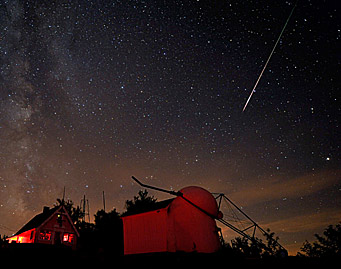 A Perseid meteor streaks across Springfield, Vermont's early morning sky. (photo: Sky and Telescope)