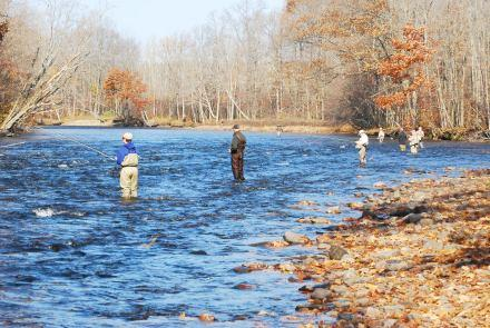 Fishing the Salmon River, one of the Lake Ontario tributaries stocked by the DEC. Photo: David Chanatry, New York Reporting Project
