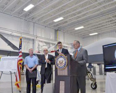 Sen. Charles Schumer, D-N.Y., speaks in support of upstate New York becoming a federally designated drone testing site. Photo: Ryan Delaney, WRVO