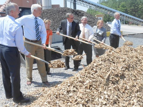 Company, state and local officials dig into a pile of wood chips at the grand opening of ReEnergy Black River on Fort Drum that is retrofitted to burn biomass instead of coal. Photo: Joanna Richards