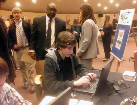 Ryan Martin, CHS sophomore, faxing legislators while we wait. Photo: Carol Pynchon