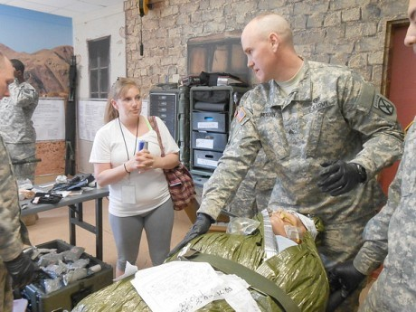 A woman speaks with an Army medic after an exercise simulating field hospital treatment during a mass casualty scenario. Photo: Joanna Richards