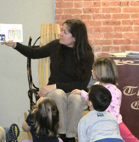 Youth Services Specialist Valerie White reads to children at the Canton Free Library.