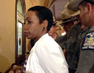 New York State NOW President Zenaida Mendez, being arrested at a sit-in at the Capitol. Photo: Karen DeWitt