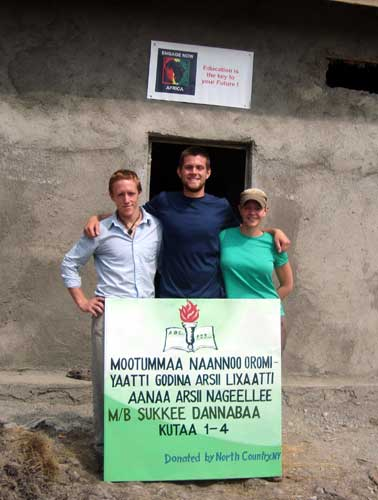 Alex French, Danny Smith and Kayla French outside the new school in Gembultu, Ethiopia.