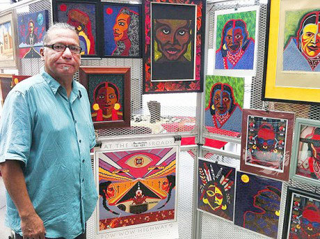 Akwesasne Mohawk collage artist, musician and poet Alex Jacobs at a display of his work in Santa Fe, New Mexico.  Photo: Todd Moe