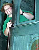 Andy Flynn aboard the H.K. Porter locomotive at the Adirondack Museum in Blue Mountain Lake
