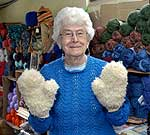Annis Holmes, of Chestertown, models a pair of hand knit Adirondack buff mittens.