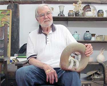 Art Sennett, holding a sculpture. Photo: Sarah Harris