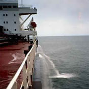 Cargo ship discharging ballast water. Photo: USCG