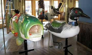 The bass and loon carousel figures in Saranac Lake. Photo: Jack Barette