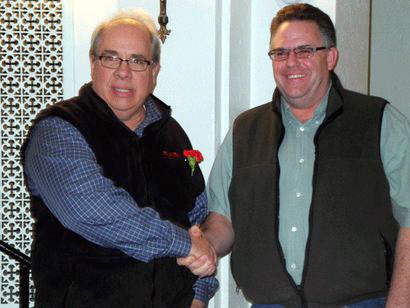 "Bob Bevilacqua (right) shakes hands with Tom Catillaz in the Harrietstown Town Hall Tuesday night after Bevilcqua defeated Catillaz in the race for Town Supervisor. Photo: Chris Knight via <a href=""http://adirondackdailyenterprise.com/page/content.detail/id/533896/Bevilacqua-wins-Harrietstown-supervisor-race.html?nav=5008"">Adirondack Daily Enterprise</a><br />"