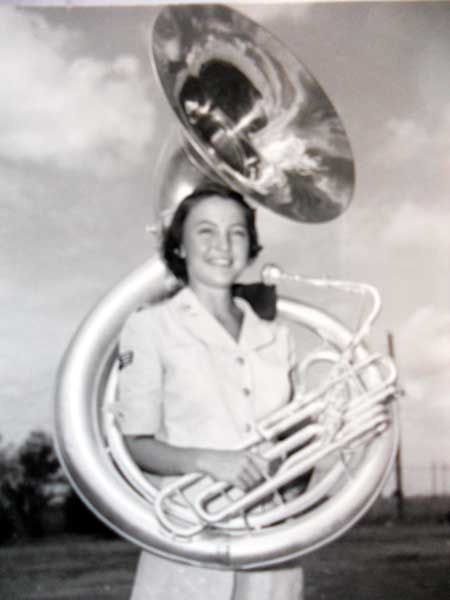 Sgt Beverly Parnell Washburn and her sousaphone in the first years of the WAF Band (above), and as assistant conductor (below).