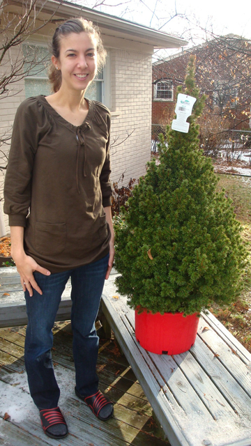 Lauren and her potted tree. It will stay outdoors until Christmas Eve, when it will be brought in for 14 hours. Photo: Jennifer Guerra