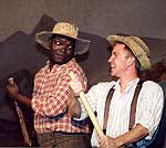 Dwelvan David as Jim, John Gardiner as Huck.