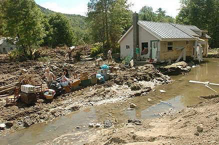 Residents move out of a house in Pittsfield, VT.  Photo: Vyto Starinskas, courtesy Rutland Herald