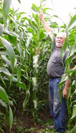 Bob Andrews measures his favorite crop.