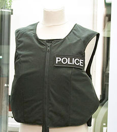 "Police body armor. Photo: <a href=""https://www.flickr.com/photos/bisgovuk/5737156828/"">Mark Prisk</a>, Creative Commons, some rights reserved"