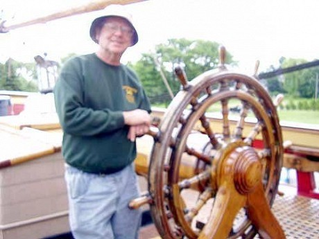 Captain Robin Walbridge, at the helm of the Bounty, while docked in Ogdensburg in 2010.  Photo:  Todd Moe