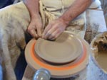 Bill Knoble shapes his clay