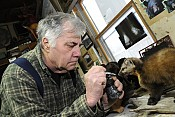 Bud Piserchia painting the nose on one of his mounts. (PHOTO:  Mark Kurtz)