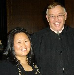 Hye Chong Yi, with Justice Thomas E. Mercure, who granted her American citizenship this morning.