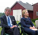McHugh and Clinton visit a farm near Fulton