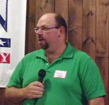 Kevin Crosby takes the mic at the St. Lawrence County Republicans meet-the-candidates dinner. Photo: Sarah Harris