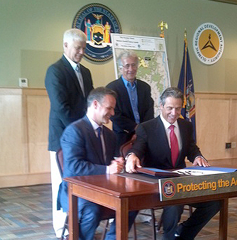 DEC Commissioner Joe Martens, standing at left, is at the center of big debates shaping the Adirondack North Country. NCPR file photo