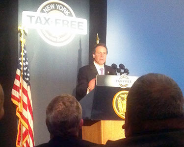 Governor Cuomo brought a multi-media presentation about his tax-cutting plan to Plattsburgh. Photo: Brian Mann, NCPR