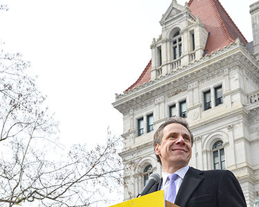 Gov. Cuomo speaking at a rally outside the Capitol in March. Photo: Office of Gov. Cuomo.
