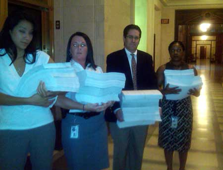 Aides to Gov. David Paterson deliver stacks of veotes to the legislature. Photo: Karen DeWitt