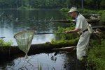 Dragonflier Nick Donnelly searches a Franklin County pond