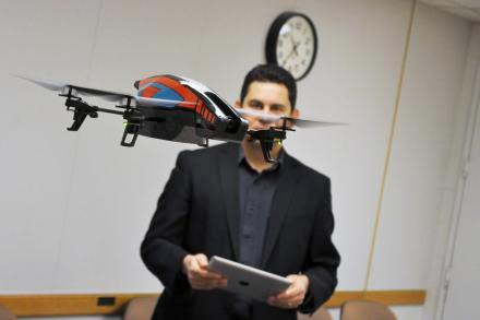 Dan Pacheco, a professor at Syracuse University, demonstrates a small drone equipped with a camera. Photo: Ryan Delaney
