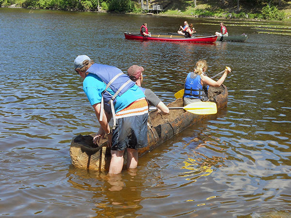 SUNY Potsdam students use Stone Age tools to build a canoe ...