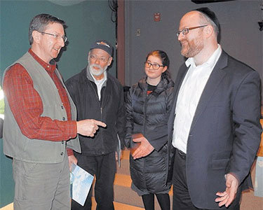 Rabbi Eli Hersh, right, talks with Paul Pillis of Gabriels at the Paul Smith's College VIC Tuesday. Also pictured are Hersh's father-in-law, Sam Bojman, and his daughter Bryna. Photo: Chris Knight, courtesy Adirondack Daily Enterprise