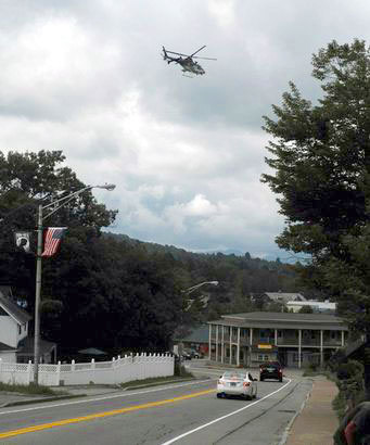 A police helicopter searches for Seth Kilburn over Lake Placid Wednesday. Photo: Richard Rosentreter via http://www.adirondackdailyenterprise.com/
