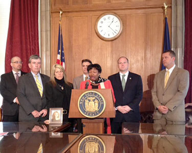NY Senate Democratic Leader Andrea Stewart Cousins at the podium along with other speakers speaking about legislation that would help address the growing opiate addiction in New York. Photo: Karen DeWitt