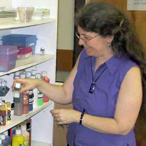 Hilary Oak sorts paint supplies in the crafts studio at the St. Lawrence County Arts Council in Potsdam.