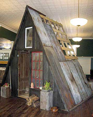 A mock A-frame cabin at the TAUNY gallery in Canton