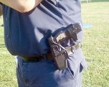 "Holstered police taser. Photo: <a href=""http://www.flickr.com/photos/doctorq/6004372352/"">Doctor Q</a>, Creative Commons, some rights reserved"