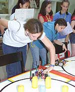 Horizons participants learn robotics design, programming, strategy and logic. Here they build competing Lego robots.