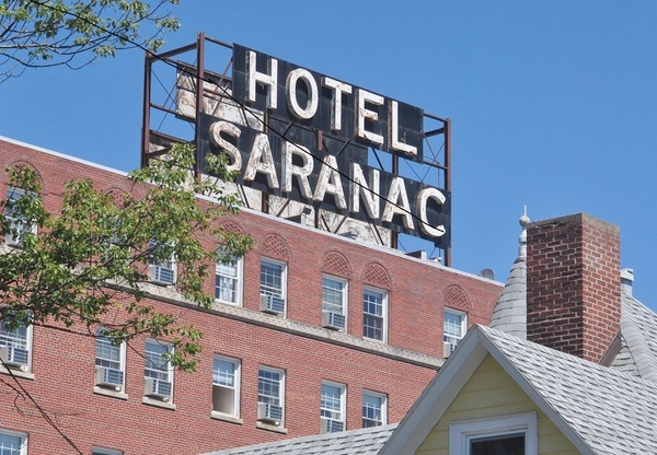The Sign Above Hotel Saranac Has Long Welcomed Visitors But For Years Destination Been In Decline Photo Susan Waters