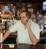 Jeff Graham tends bar and fields political calls.