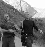 Paramedics Joe Connelly(L) & Phil Suarez in NorDijhia carrying sick baby (Source:  Phil Suarez)