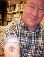"Jon Montan shows off his ""Don't Burn"" tattoo"