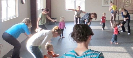 Being an airplane, at the Yoga Loft's Little Lotus class in Canton. Photo: Christopher Shrope