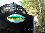 Brian Mann aboard an Adirondack locomotive