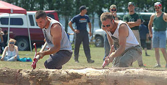 Log rolling at the annual Tupper Lake event.  Photo: Tupper Lake Woodsmen's Association