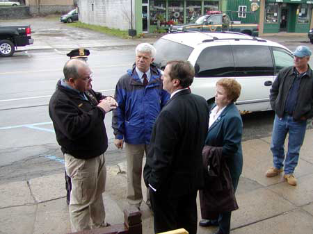 Franklin County emergency services coordinator Rick Provost in Tupper Lake with DEC Commissioner Joe Martens), state environmental facilities head Matt Driscoll, Assemblywoman Janet Duprey, and  Tupper Lake Supervisor Roger Amell.